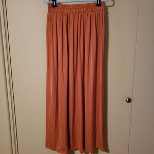A salmon colored maxi skirt